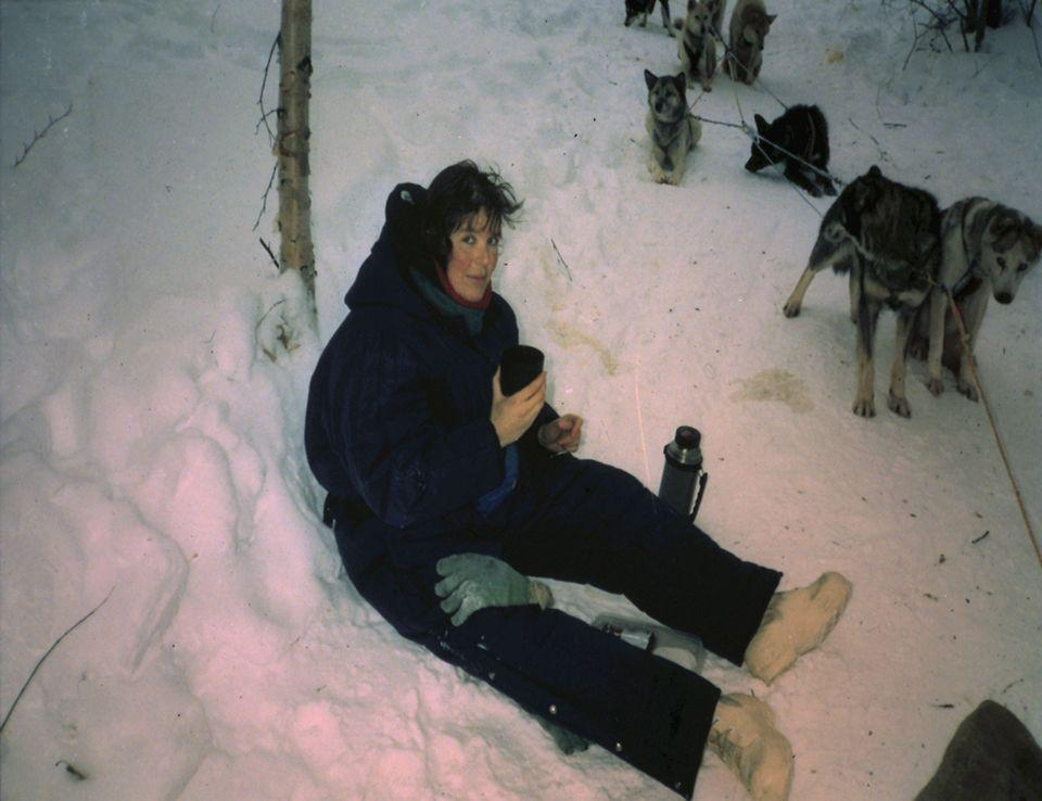 Taking a break while dogsledding.